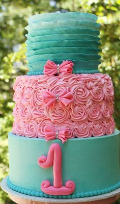 Ombré Teal Ruffles and Pink Rosettes Cake