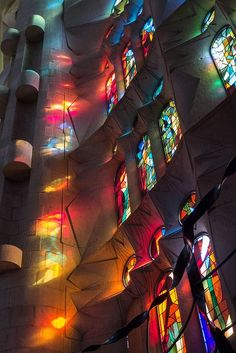 Stained glass window La Sagrada Familia. Antoni Gaudi. Barcelona, Spain. Gaudi started work on the project in 1883. Building still under construction. Estimated completion 2026.