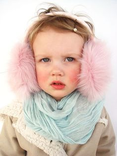 We're not sure what's cuter — these pink faux-fur muffs or those rosy cheeks. #etsy #etsykids