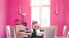 painterly peony graces the walls of this jewel box dining room.