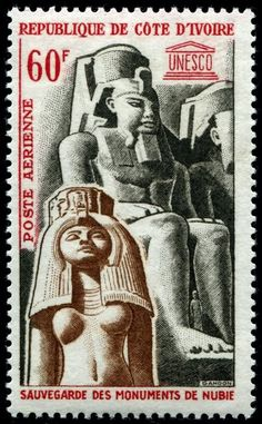 Airmail stamp depicting the monumental statues of Pharoah Ramses II and his wife, Nefertari, at Abu Simbel, designed and engraved by Pierre Gandon, and issued by Ivory Coast on March 7, 1964 to publicize UNESCO and promote the safeguard of these Nubian monuments, Scott No. C27.
