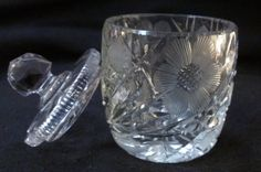 This is a beautiful Heisey Cut Crystal Mustard, Jam, Condiment Jar made in the 1940's. Has a button and flower pattern etched into the cut crystal. The lid is ridged and has a slot for a spoon. 2 1/2 inches in diameter and 4 1/2 inches tall. No dings or chips in lid or jar. Truly a beautiful piece of glass artwork that would look great on anyone's table.      To view other glassware items in my shop click here: https://www.etsy.com/shop/RubyLaneTreasures?ref=hdr_shop_menu§ion_id=19056228…