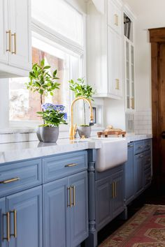 Benjamin Moore in the kitchen: upper cabinets & walls - Swiss Coffee; lower cabinets: HC-145 Van Courtland Blue.