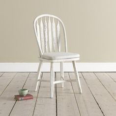 The pair of distressed white chairs would work wonderfully with either a wooden or painted table. Dimensions:98H x 51W x 41D