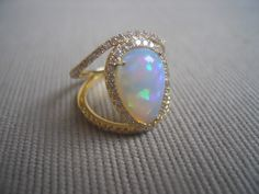 ILOP ring Ethiopian opal, diamonds, 18k yellow gold.