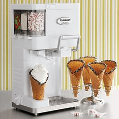 Oh my gosh - are you kidding me?! Waaayy too awesome! It makes, dispenses and does toppings!! I like that it does sorbet, frozen yogurt or gelato, in addition to ice cream. Mmmmm... possibilities are endless!