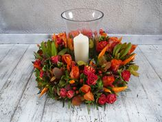 An autumnal Storm Lantern floral arrangement in feiry reds and oranges. Perfect for a Wedding, Event or in your home! Storm Lantern, Autumnal, Floral Arrangements, Bouquets, Lanterns, Seasons, Table Decorations, Create, Flowers