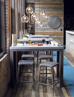 I like the palette wall with the grey weathered wood. This could work in Conf room