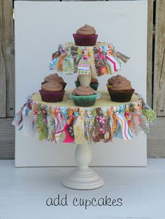Cute cake stand made with embroidery hoops! Can also do this same look with milk glass stands that have a pierced edge! Use fabrics or ribbons!