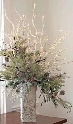 Winter or Christmas wedding arrangement idea - love the lighted branches!