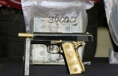 Drugs and money found in Mexican drug dealers home after being raided. 22 billion in cash found in the house! Magnum semi-automatics with solid gold grips.