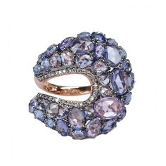 Sapphire Wave Ring. Bright rose cut blue sapphire gems are set in a glittering wave in this graceful ring by Etho.