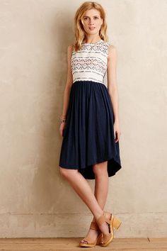 I love the tribe-inspired print on top and high waist/uneven hem skirt. Sabado Dress - anthropologie.com