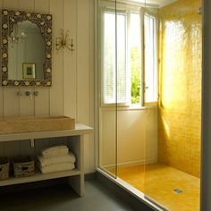 See all our stylish bathroom design ideas, including this bathroom with a yellow tiled wet room shower, and ornate lighting
