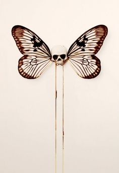 Tattoo inspiration... by D*Face #Skulls #Butterfly