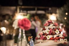 Beautiful Wedding Cake with Flowers, Blueberries, Strawberries and Lace