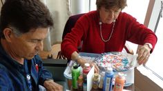 """Max Chavez, a University of New Mexico Hospital cancer patient, and his wife, Beth, work on art projects. Chavez makes greeting cards and says the art projects give him """"something to do creatively that I wasn't doing because I was pretty depressed."""""""