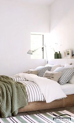white beroom clean fresh with pops of color green for teen guest bedroom idea