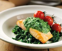 Salmon with Creamed Spinach Sauce on Wilted Kale