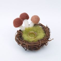 This is adorable. I made this item a favorite. I would just set it on a dresser to catch rings since I don't see the need to use for a ring bearer anytime soon. Very cute though.