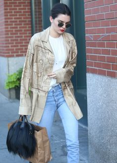 Pin for Later: These Stars Are Already Wearing Fall's Hottest Trends — and Here's How You Can Too A Furry Bag Despite the heat, Kendall recently broke out her favorite furry Givenchy bag in NYC, proving this material isn't exclusive to colder months.