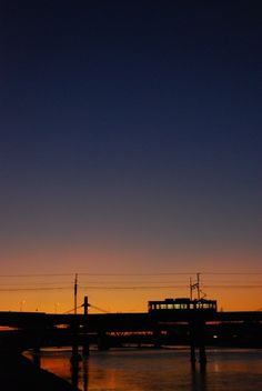 A small train crossing the river 大和川を渡る阪堺電車 Japanese Landscape, Magic Hour, Spirited Away, Seaside Towns, Indian Paintings, Beautiful Scenery, Studio Ghibli, Aesthetics, Clouds