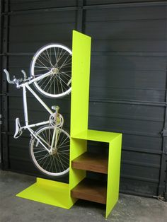 Commuter bike rack, designed by Sarabi Studio in collaboration with Urbanspace Interiors.    An interesting take on a bike rack for urban spaces. Great collaboration between furniture design studio and and interior design company. Transforming something as simple as a bike rack into a fine piece of furniture.
