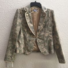 Sassy blazer, floral print Blazer, in perfect condition in a soft floral print. No longer new with tags. I couldn't take it anymore and wore it to work :). Super cute and lots of compliments! Color is tough to photograph, but is a beige/grey and off white. Trim is beige. Sleeves fit me as 3/4 sleeves, but I have long arms. Totally Anthropologie-esque and beautifully made. Cass Jackets & Coats Blazers