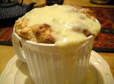 """My husband's favorite thing in the world is bread pudding practically. He was recently gone on a business trip and left me all by myself for almost a week, which got me lonesome! Got missing him, so I started thinking about bread pudding. I got remembering the yummy white chocolate and dark chocolate ganache bread pudding we had on our honeymoon, and then immediately got experimenting! (On our honeymoon the bread pudding was called a """"bitter blanc"""" bread pudding. )The resulting recipe is…"""