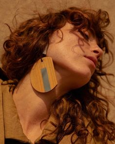 Sculptural wooden earring from @neheraofficial - available now