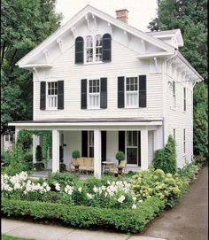 So beautiful, I love the attic windows and shutters. Not to mention the porch & garden.