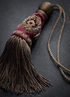 Cordelia key tassel is hand-embroidered with metal thread on Capri silk velvet…