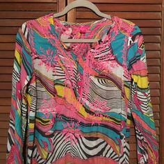 ❗️SALE❗️VINTAGE psychedelic print tunic top COOL True Vintage psychedelic print tunic top multicolor print with pink embroidery on front back and cuff Vintage 60s-70s slit up sides COOL! If this fit granny it wouldn't be leaving my closet! Love it. 100% cotton semi sheer pinks blues white yellow. Under arms / bust 36in length 35in wear with your favorite jeans leggings or as a cover up. Very good vintage condition. Love ya. Tops Tunics