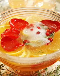 Horse and Carriage Punch- The addition of sparkling champagne makes this sweet-tart punch the perfect centerpiece for a holiday bar. Pomegranate seeds and rose petals provide a festive finishing touch. Also Try: Christmas Rum Punch