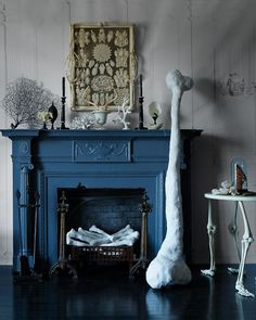 "Plaster bones: The ""Flintstones""-size femur and the heap of humeri posing as logs in the fireplace are made from newspaper wrapped in plaster cloth."