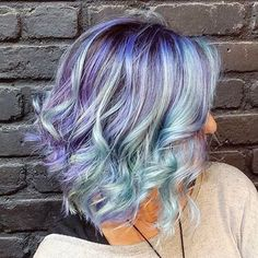 short wavy hair ombre made with purple and pastel blue hair colors. See more at http://www.hairchalk.co #haircolor #hairdye #hairchalk