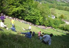 Cooper's Hill Cheese-Rolling and Wake is an annual event held on the Spring Bank Holiday at Cooper's Hill near Gloucester, England. A Double Gloucester cheese is rolled from the top and competitors race down the hill for it. Spring Bank Holiday, Village Fete, British Sports, Cheese Rolling, English Village, Thing 1, Great British, Weird And Wonderful, Festivals