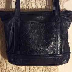 Gorgeous Vintage hand tooled bag In very good condition, beautiful bag. Soft supple leather and beautiful details on front and back. Has one zippered area inside to store misc. great bag I just don't use anymore. Dry Creek Leather Bags