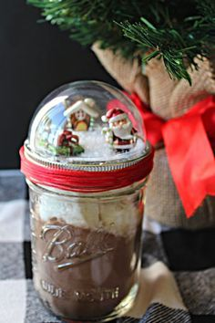 Fun Gift Idea: How to Make Your Own Snow Globe Mason Jars! Need a fun, last-minute gift idea? Make these snow globe mason jars and fill them with all sorts of goodies! Perfect for. Mason Jar Lids, Mason Jar Crafts, Candy Gifts, Jar Gifts, Cookie Mix Jar, Snow Globe Mason Jar, Hot Chocolate In A Jar, Chocolate Bars, Graduation Gifts For Boys