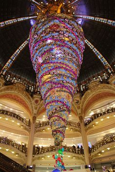 """Youtube: click through to watch the construction the upside-down 25 meter Christmas tree at the Galeries Lafayette department store in Paris, on display through 5 January 2015. Visit the store's webpage about the tree and their Christmas 2014 """"monster"""" window decorations: http://www.galerieslafayette.com/carnet-mode/whats-new/on-y-etait-lillumination-du-sapin-inverse-noel-monstre-galeries-lafayette/"""