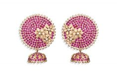 Rasvihar Roshni  Lustrous rubies closely set on the gleaming disc of gold and handcrafted flowers of burnished gold unite to form the large, ravishing ear stud. Three brilliant cut diamonds set in the centre of each flower adds a cheerful sparkle to the warm gold. The small jhumka that drops down is gorgeously embellished with closely packed rubies and petals of gold.  Shop Online: http://www.parisera.com/products/rasvihar-roshni?cid=25