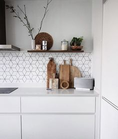 stylist and luxury kitchen wall tiles design. white matte kitchen with wooden chopping boards open shelf cube tiles and  concrete floor those though 28 Gorgeous Modern Scandinavian Interior Design Ideas