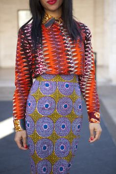 I love a girl who isn't afraid to rock a pattern combo like this. fabulous.