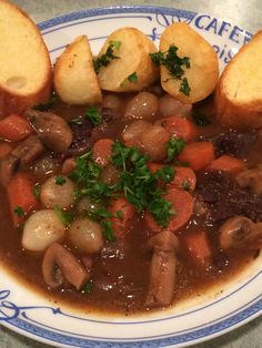 Ina Garten's easy boeuf bourguignon.  Oh, what a fantastic, rich recipe.  I made some potatoes roasted in duck fat and garlic bread to go with it.  I also used a nice bottle of French wine in it.  Perfect!