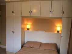 Simple above bed cabinets. I like the fixtures