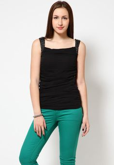 A black coloured, sleeveless top for women from Species. Made from georgette, this top features waist length.