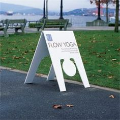 Stretch, Pull and Push - 8 Brilliant Ways of Selling Yoga - This would be an awesome sign with a gymnast