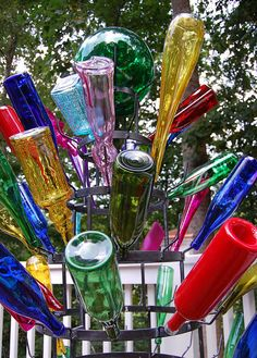 bottle tree, love the different shape bottles in this one