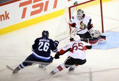 CrowdCam Hot Shot: Ottawa Senators goalie Robin Lehner makes a save on Winnipeg Jets forward Blake Wheeler during the second period at MTS Centre. Photo by Bruce Fedyck