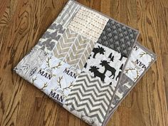 This adorable woodland animals themed quilt features bucks, deer, moose, arrows and modern chevrons in neutral colors ranging from white, cream, and tan to gray and brown. The prints are modern yet rustic. The baby size is good for decoration or a play mat while the toddler size is